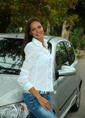 Beautiful young woman in car — Stock Photo