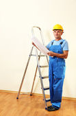 Architect studying construction project — Stock Photo