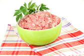 Bowl of raw ground meat isolated on white — Photo