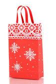 Vánoční papírový sáček pro dary, izolované na bílém — Stock fotografie