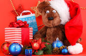New Year composition of New Year's decor and gifts on red background — Photo