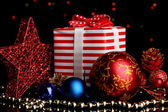 New Year composition of New Year's decor and gifts on Christmas lights background — Photo