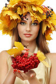 Beautiful young woman with yellow autumn wreath and viburnum, isolated on white — Stock Photo