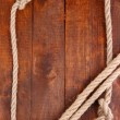 Stock Photo: Frame composed of rope on wooden background