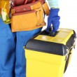 Male builder in blue overalls with yellow suitcase isolated on white — Stok fotoğraf