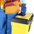 Male builder in blue overalls with yellow suitcase isolated on white — Stockfoto