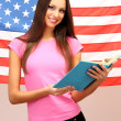 Young woman with American flag — Stock Photo #15740427
