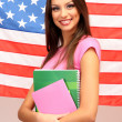 Young woman with American flag — Stock Photo #15740439