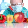 Stock Photo: Scientist injecting GMO into vegetables