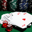 Cards, dices and chips for poker on green table — Stock Photo