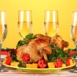 Banquet table with roast chicken on orange background close-up. Thanksgiving Day — Stock Photo #15744749