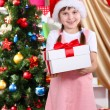 Stock Photo: Little girl with Christmas toys in festively decorated room