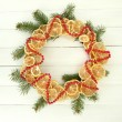 Christmas wreath of dried lemons with fir tree, on white wooden background — Stok fotoğraf