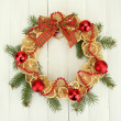 Christmas wreath of dried lemons with fir tree and balls, on wooden background — ストック写真