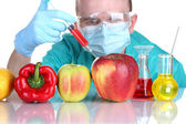 Scientist injecting GMO into the vegetables — Stock Photo