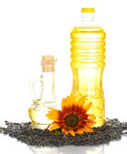 Sunflower oil in a plastic bottle and small decanter isolated on white background — Stock Photo