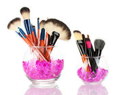 Make-up brushes in two bowls with stones isolated on white — Stock Photo