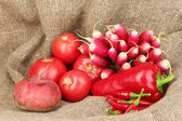Fresh red vegetables on sackcloth background — Stock Photo