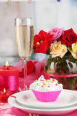 A delicious creamy dessert on celebratory table of Valentine's Day on room background — Stock Photo