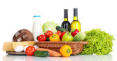 Composition with vegetables in wicker basket isolated on white — Stock Photo