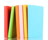 Stack of multicolor books isolated on white — Stok fotoğraf