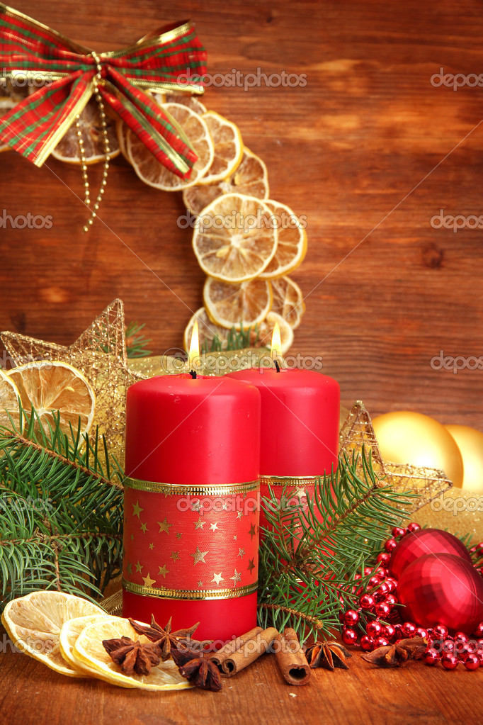 Two candles and christmas decorations, on wooden background — Stock Photo #15747391