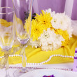 Serving fabulous wedding table in purple and yellow color on white and purple fabric background — Stock Photo