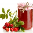 Jar with hip roses jam and ripe berries, isolated on white — Stock Photo #15831857