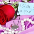 Heart pendant with red rose — Stockfoto