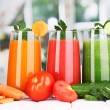 Fresh vegetable juices on wooden table, on window background — Stock Photo #15833659