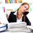 Stock Photo: Office worker with documents in her workplace