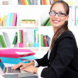 Young pretty business woman with notebook in office — Stock Photo