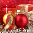 Christmas decoration and gifts on red background — Stock Photo