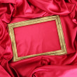 Empty frame on beautiful silk — 图库照片