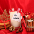 Cookies for Santa: Conceptual image of ginger cookies, milk and christmas decoration on red background — Stock Photo #15835263