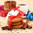 Stock Photo: Cookies for Santa: Conceptual image of ginger cookies, milk and christmas decoration on light background