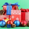 New Year composition of New Year's decor and gifts on green background - Stock Photo