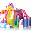 Royalty-Free Stock Photo: Color bucket with multicolor ribbons and thread isolated on white