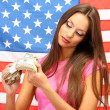 Young woman with American flag — Stock Photo #15836549