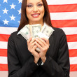 Stock Photo: Young woman with American flag