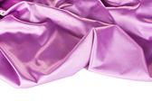 Purple silk drape isolated on white — Stock Photo