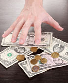 Money, which take hands on wooden table background — Stock Photo