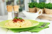 Italian spaghetti served in cafe — Stock Photo