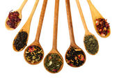 Assortment of dry tea in spoons, isolated on white — Stock Photo
