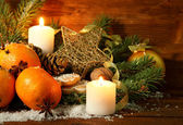 Christmas composition with oranges and fir tree, on wooden background — Stock Photo