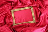 在美丽的丝绸上的空框架 — 图库照片