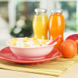 Tasty dieting food and bottles of juice, on wooden table — Foto de Stock