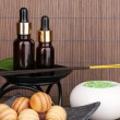 Aromatherapy setting on brown bamboo background — Stock Photo #15843117