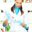 Young scientist in laboratory — Stock Photo #15844415