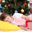The little girl fell asleep with gift in their hands in festively decorated room — Stock Photo #15844451
